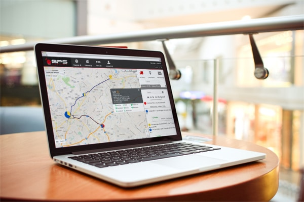 GPS Vehicle Tracking Solutions on Office Laptop